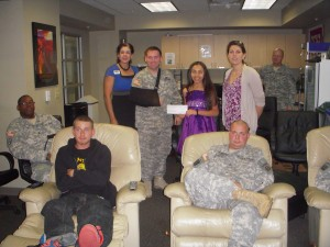 Alina Galvan presenting check to our wounded troops.