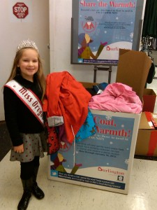 Deja giving coats for Burlington Coat Drive and Good Morning America