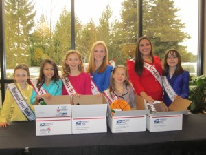 Oregon Queens packing boxes to send to our troops
