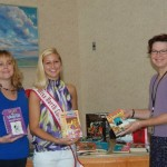 Megan Ebert, NC Teen Queen, giving books to the library