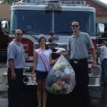 Abigail Satter donating books and animals at local Fire Department.