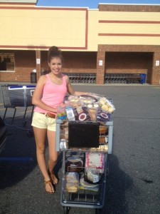 Abigail Satter NC Jr. Teen Queen helping at Clemmons food pantry.