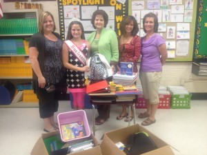 Taylor Parsons donates school supplies to local school.