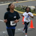 miss_oregon_preteen__hailey_kilgore_crosses_the_camp_quest_fun_run_finish_line_with_her_youngest_teammate (2)