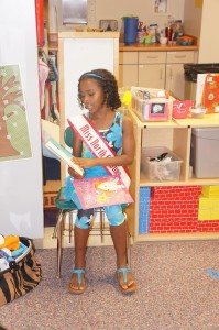 Niyah reading to the children