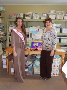 Donating items to the Women's Enrichment Center, a ministry that provides a safe and caring environment for women who are facing an unplanned pregnancy.